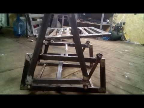 Кресло качалка маятниковое из металла